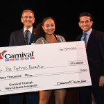"""Gary LaGrange, President and CEO of the Port of New Orleans, singer Robin Barnes, representing the Tipitina's Foundation, and Carlos Torres de Navarra, Commercial Port Operations for Carnival Cruise Line pose for a photo with first place winnings in fun """"minute to win it"""" style games for $35,000 in charitable donations for four local New Orleans non-profit music organizations. The event was held at the Port of New Orleans aboard the Carnival Triumph which kicks off year-round four- and five-day service from the Big Easy today."""