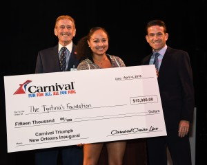 "Gary LaGrange, President and CEO of the Port of New Orleans, singer Robin Barnes, representing the Tipitina's Foundation, and Carlos Torres de Navarra, Commercial Port Operations for Carnival Cruise Line pose for a photo with first place winnings in fun ""minute to win it"" style games for $35,000 in charitable donations for four local New Orleans non-profit music organizations. The event was held at the Port of New Orleans aboard the Carnival Triumph which kicks off year-round four- and five-day service from the Big Easy today."