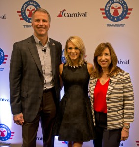 From left, Brig. Gen. John Pray, president and CEO of Operation Homefront; country music artist Carrie Underwood; and Christine Duffy, president of Carnival Cruise Line; pose prior to a news conference Thursday, Jan. 28, 2016, in Jacksonville, Fla., to announce a new initiative to support U.S. military families. The effort between the three entities is to raise funds through a series of projects during Underwood's concert tour and aboard Carnival's ships as well as the company's website. FOR EDITORIAL USE ONLY (Andy Newman/Carnival Cruise Line/HO)