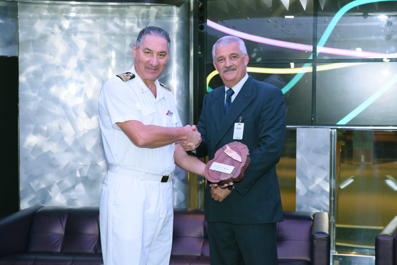 Carnival Magic's Inaugural Call in Aruba Commemorated with Traditional Maritime Plaque Exchange