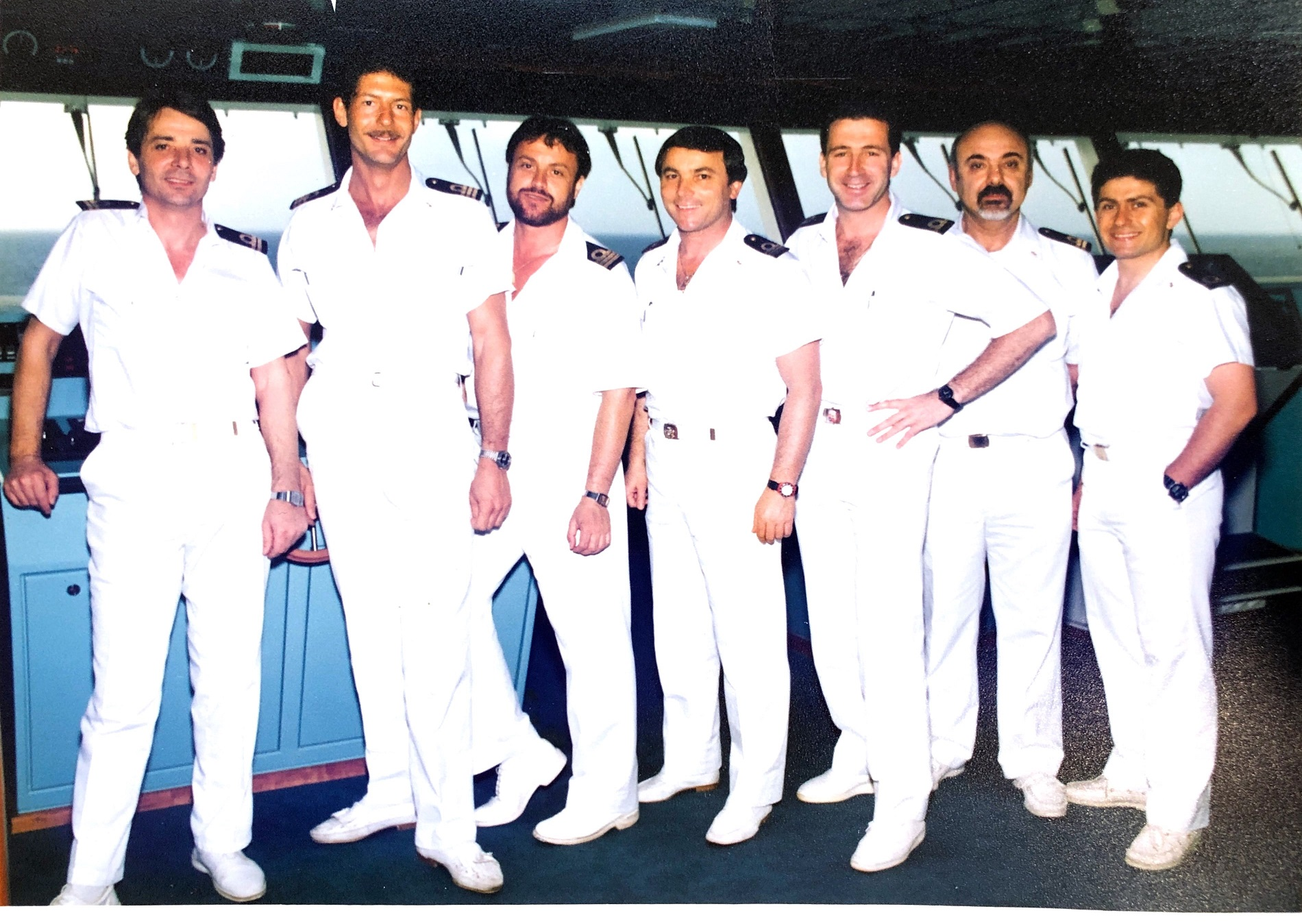 Carnival Fantasy's officers, including eventual Captains Alessandro Galotto (second from left) and Gaetano Gigliotti (third from right) are shown here on the ship's navigational bridge during start-up